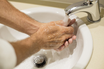 Close-up of a man washing his hands