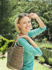 Smiling woman carrying a bag