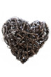 Close-up of a heart shaped showpiece made from wicker and twigs