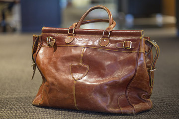 Close-up of a leather purse on an airport