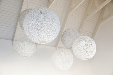 Low angle view of nest shaped lamps hanging from ceiling, South Africa