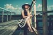 Stylish beautiful  woman on an old pier