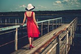 Stylish beautiful  woman on an old pier