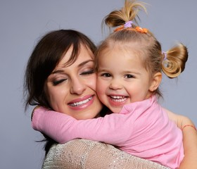 Happy young mother hugs her daughter