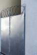 Closed door with razor wire
