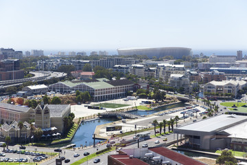 Elevated view of buildings in a city with Green Point Soccer Stadium in the background, Cape Town, South Africa