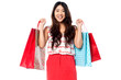 Young shopaholic girl with vibrant bags