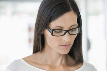 Close-up of a woman wearing eyeglasses