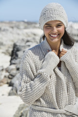 Beautiful woman on the beach in winter