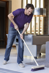 Man cleaning floor with a mop