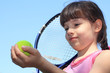 Portrait of a young girl with a tennis racket.