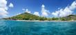 White coral sand on tropical beach. La Digue island, Seyshelles.