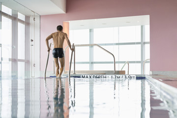 Man coming out from a swimming pool
