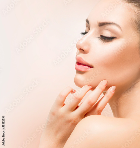 Spa Girl. Beautiful Young Woman Touching Her Face