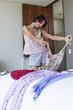 Woman choosing dress at home