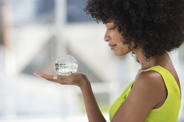 Close-up of a woman holding a crystal ball
