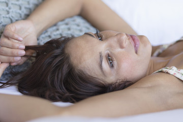 Woman lying on the bed and thinking