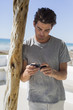 Man reading text message on a mobile phone