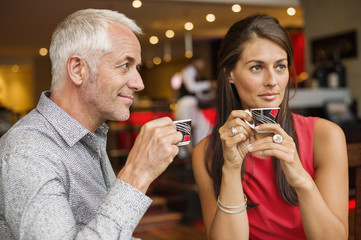 Couple enjoying cup of tea in a restaurant