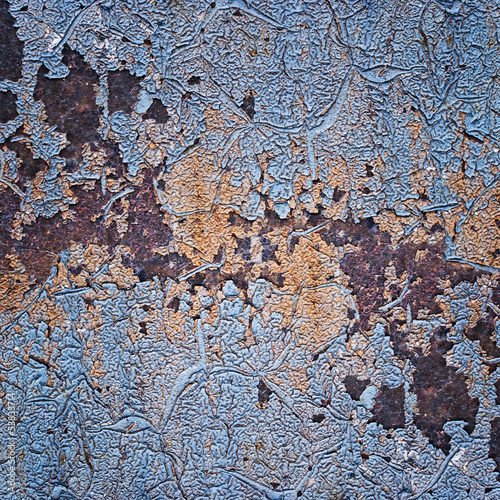 Metal surface with old paint and rust spots. Grunge texture