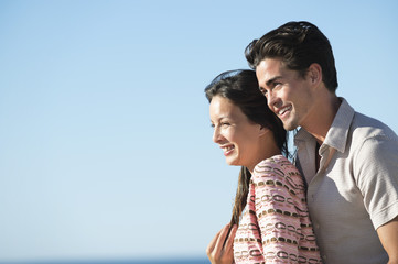 Romantic couple smiling on the beach