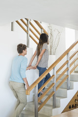 Couple moving up a staircase