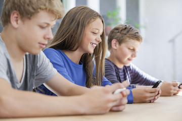 Students using electronic gadget in a classroom