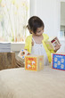Girl playing with nested cubes