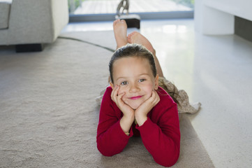 Girl lying on a carpet at home