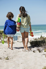Girl and a boy walking on the beach