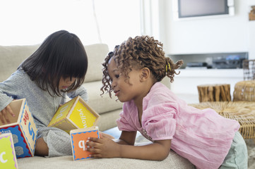 Two girls playing with number blocks