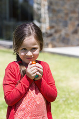 Close-up of a girl holding Easter eggs in a lawn