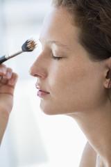 Woman brushing her eyebrow