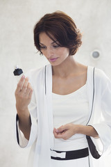Woman looking at a cosmetics product