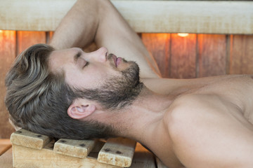 Close-up of a man resting in a sauna
