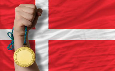 Gold medal for sport and  national flag of denmark