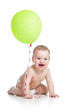 Smiling baby boy  with green ballon in his hand isolated on whit
