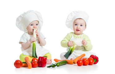 children boy and girl wearing chef hat with healthy  food vegeta