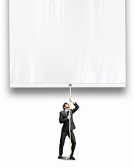 Businessman pulling banner