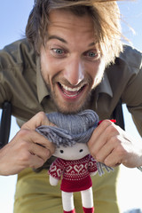 Man playing with a rag doll