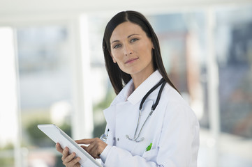 Portrait of a female doctor using a digital tablet