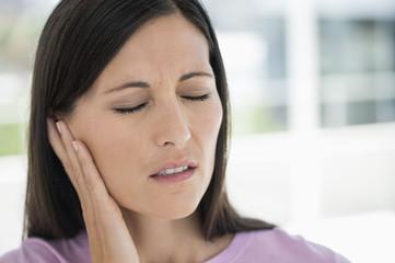 Woman suffering from an ear ache