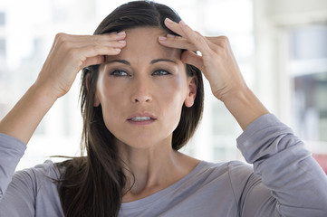 Close-up of a woman suffering from a headache