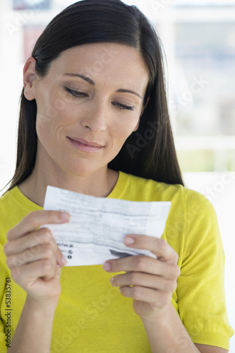 Woman reading instructions before taking medicine