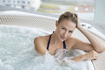 Portrait of a beautiful woman in a hot tub