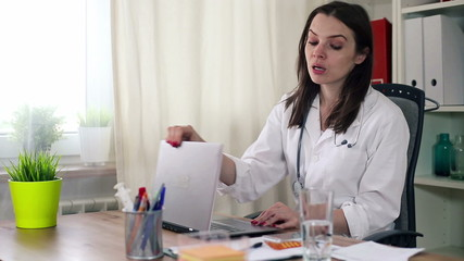 Female doctor taking pill for her headache