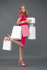 Portrait of a woman posing with shopping bags and smiling