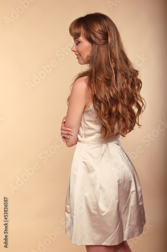 Hairstyle. Brown Hair. Beautiful girl with long Curly Hair.