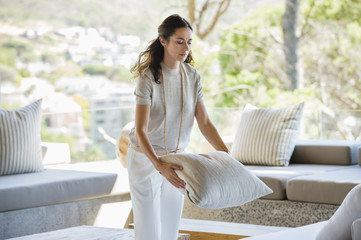 Woman holding a pillow at home