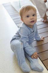 Portrait of a baby boy sitting on the floor